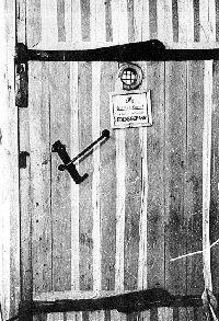 Auschwitz: wooden delousing chamber door